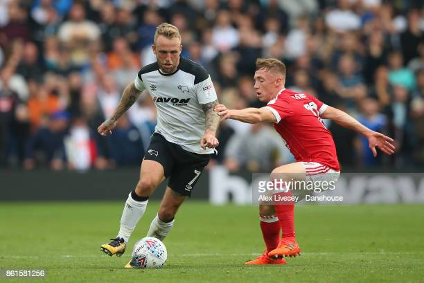 Johnny Russell of Derby County beats Ben Osborn of Nottingham Forest during the Sky Bet Championship match between Derby County and Nottingham Forest...