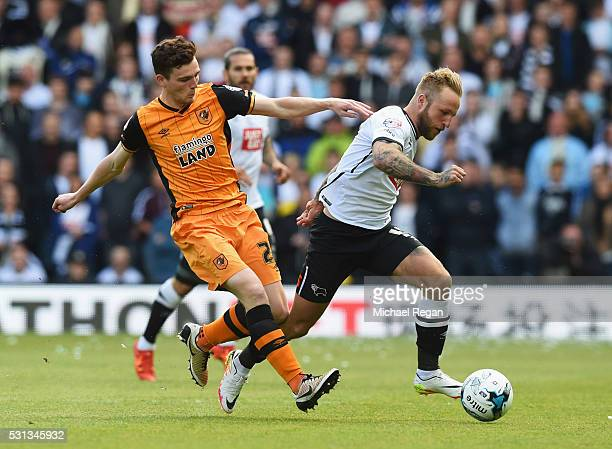Johnny Russell of Derby County evades Andrew Robertson of Hull City during the Sky Bet Championship Play Off semi final first leg match between Derby...