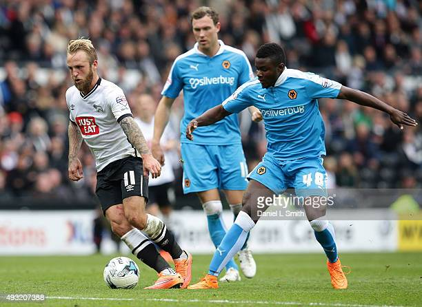Johnny Russell of Derby County FC maintains control over Bright Enobakhare of Wolverhampton Wanderers FC during the Sky Bet Championship match...