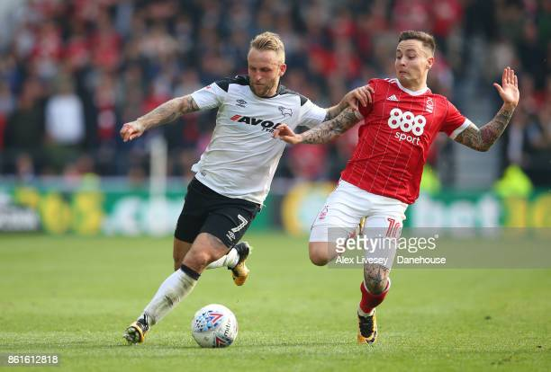 Johnny Russell of Derby County is challenged by Barrie McKay of Nottingham Forest during the Sky Bet Championship match between Derby County and...