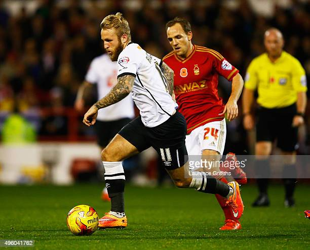Johnny Russell of Derby County is chased by David Vaughan of Nottingham Forest during the Sky Bet Championship match between Nottingham Forest and...