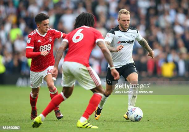 Johnny Russell of Derby County takes on Zach Clough and Armand Traore of Nottingham Forest during the Sky Bet Championship match between Derby County...