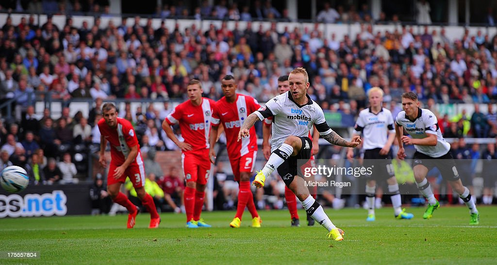 Johnny Russell of Derby scores a penalty to make it 1-0 during the Sky Bet Championship match between Derby County and Blackburn Rovers at Pride Park Stadium on August 04, 2013 in Derby, England,