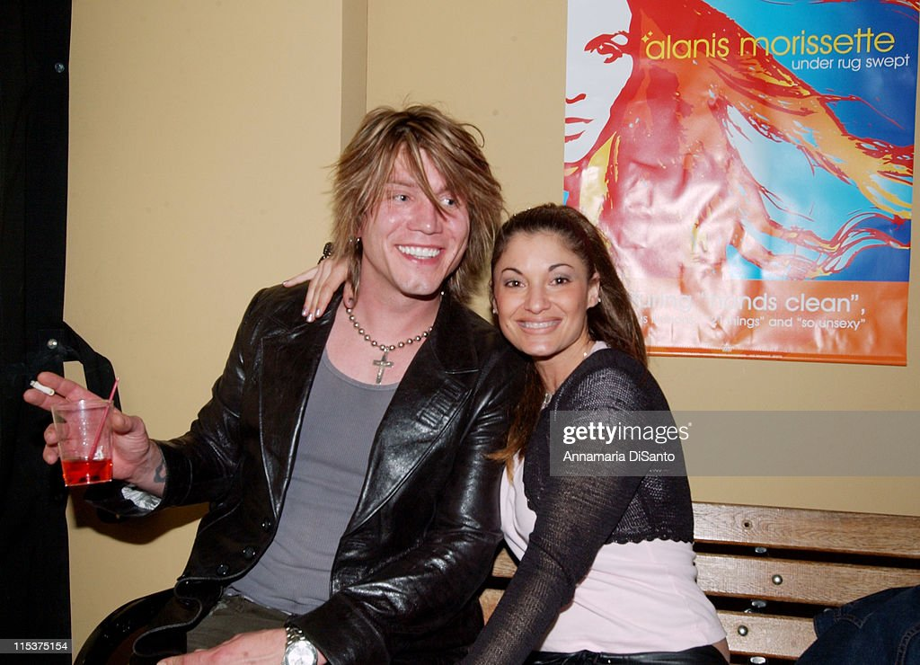 Johnny Rzeznik and friend at Alanis Morissette's record release party The new album is titled 'Under Rug Swept'