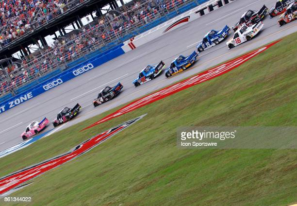 Johnny Sauter Allegiant Travel Chevrolet Silverado leads during the Fred's 250 NASCAR Camping World truck race on October 14 at the Talladega...