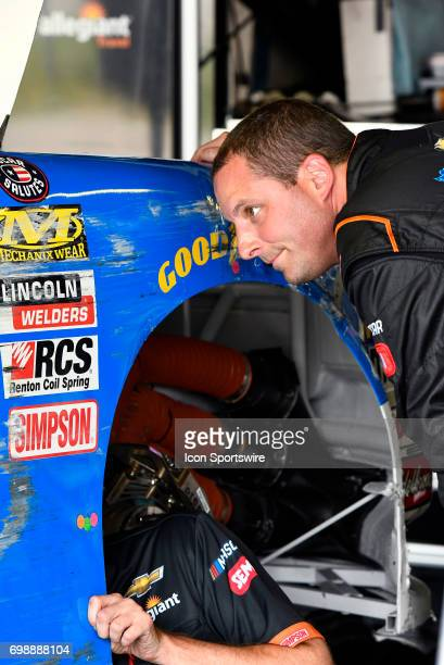 Johnny Sauter Chevrolet Silverado inspects damage to his truck during practice for the NASCAR Camping World Truck Series Drivin' for Linemen 200 on...
