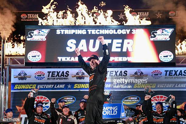 Johnny Sauter driver of the Allegiant Travel Chevrolet celebrates in Victory Lane after winning the NASCAR Camping World Truck Series Striping...