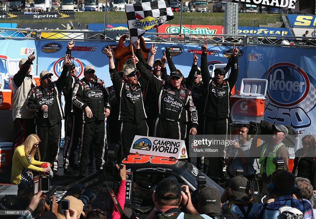<a gi-track='captionPersonalityLinkClicked' href=/galleries/search?phrase=Johnny+Sauter&family=editorial&specificpeople=234871 ng-click='$event.stopPropagation()'>Johnny Sauter</a>, driver of the #98 Carolina Nut Co./Curb Records Toyota, celebrates in Victory Lane after winning the NASCAR Camping World Truck Series Kroger 250 on April 6, 2013 at Martinsville Speedway in Ridgeway, Virginia.