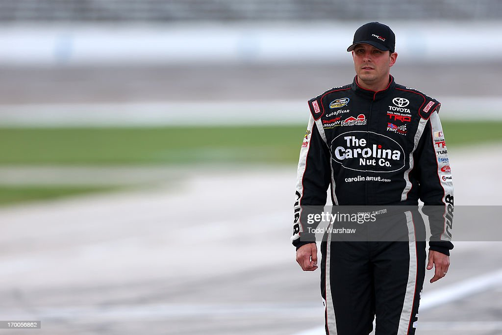 <a gi-track='captionPersonalityLinkClicked' href=/galleries/search?phrase=Johnny+Sauter&family=editorial&specificpeople=234871 ng-click='$event.stopPropagation()'>Johnny Sauter</a>, driver of the #98 Carolina Nut Co./Curb Records Toyota, walks on the grid during qualifying for NASCAR Camping World Truck Series WinStar World Casino 400 at Texas Motor Speedway on June 6, 2013 in Fort Worth, Texas.