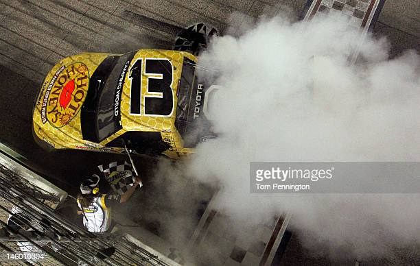 Johnny Sauter driver of the Hot Honeys/Curb Records Toyota performs a burnout to celebrate winning the NASCAR Camping World Series WinStar World...