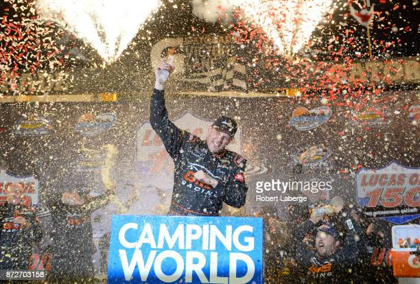 Johnny Sauter driver of the ISMConnect Chevrolet celebrates in victory lane after winning the NASCAR Camping World Truck Series Lucas Oil 150 at...
