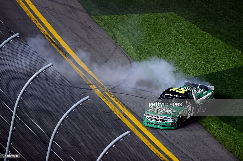 Johnny Sauter driver of the Smokey Mountain Herbal Snuff Chevrolet celebrates winning the NASCAR Camping World Truck Series NextEra Energy Resources...