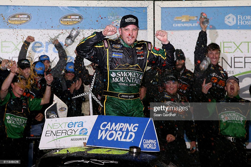 Johnny Sauter driver of the Smokey Mountain Herbal Snuff Chevrolet celebrates in Victory Lane after winning the NASCAR Camping World Truck Series...