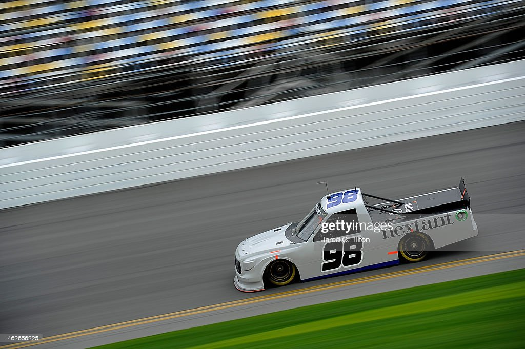 <a gi-track='captionPersonalityLinkClicked' href=/galleries/search?phrase=Johnny+Sauter&family=editorial&specificpeople=234871 ng-click='$event.stopPropagation()'>Johnny Sauter</a> drives the #98 Thorsport Toyota during NASCAR Preseason Thunder at Daytona International Speedway on January 14, 2014 in Daytona Beach, Florida.