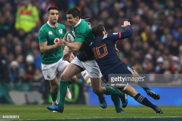 Johnny Sexton of Ireland is tackled by Camille Lopez of France during the RBS Six Nations match between Ireland and France at the Aviva Stadium on...