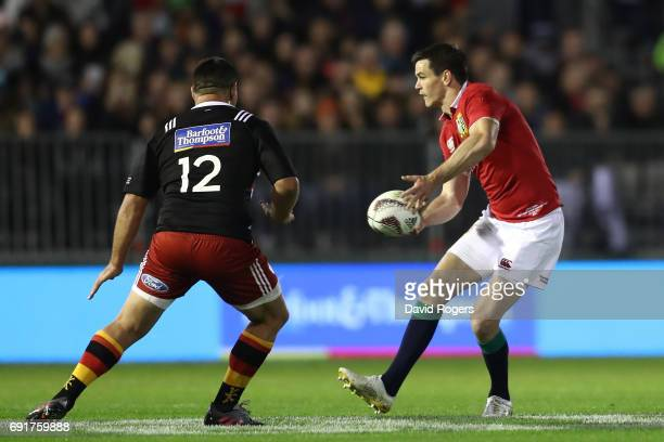 Johnny Sexton of the British Irish Lions passes the ball as Dwayne Sweeney of NZ Provincial Barbarians closes in during the 2017 British Irish Lions...