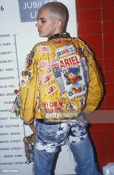 Johnny Slut wearing a customised MA1 Flight jacket with safety pins and brand logos Late 1980s