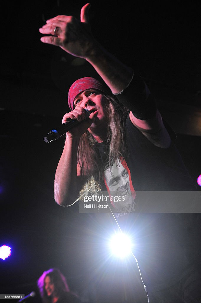 Johnny Solinger of Skid Row performs on stage at Manchester Academy on October 24, 2013 in Manchester, England.