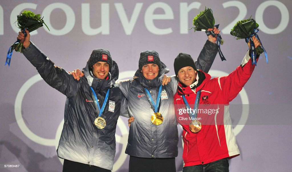 <a gi-track='captionPersonalityLinkClicked' href=/galleries/search?phrase=Johnny+Spillane&family=editorial&specificpeople=726088 ng-click='$event.stopPropagation()'>Johnny Spillane</a> of the United States receives the silver medal, <a gi-track='captionPersonalityLinkClicked' href=/galleries/search?phrase=Bill+Demong&family=editorial&specificpeople=815556 ng-click='$event.stopPropagation()'>Bill Demong</a> of the United States receives the gold medal and <a gi-track='captionPersonalityLinkClicked' href=/galleries/search?phrase=Bernhard+Gruber&family=editorial&specificpeople=824521 ng-click='$event.stopPropagation()'>Bernhard Gruber</a> of Austria receives the bronze medal during the medal ceremony for the men's individual large hill 10 km Nordic combined on day 14 of the Vancouver 2010 Winter Olympics at Whistler Medals Plaza on February 25, 2010 in Whistler, Canada.