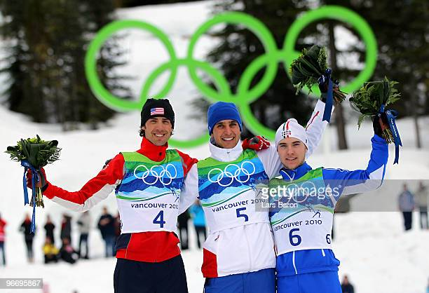 Johnny Spillane of United States Jason Lamy Chappuis of France and Alessandro Pittin of Italy pose during the flower ceremony following the Nordic...
