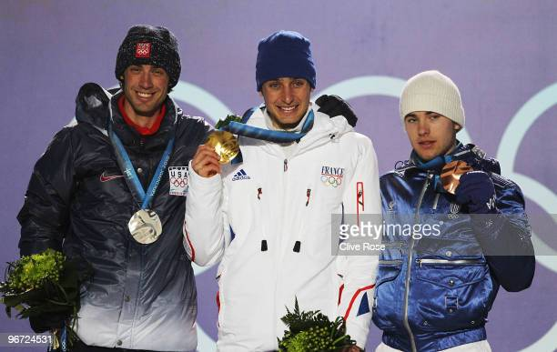 Johnny Spillane of United States Jason Lamy Chappuis of France and Alessandro Pittin of Italy pose with their medals during the Medal ceremony for...