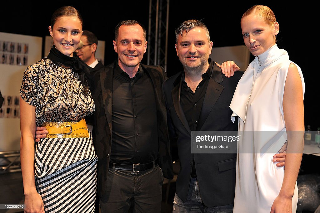 Johnny Talbot and Adrian Runhof of Talbot Runhof pose backstage with models after their show during the third day of the Charles Voegele Fashion Days on November 11, 2011 in Zurich, Switzerland.