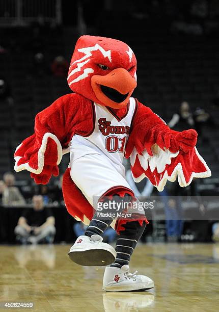 Johnny the Thunderbird mascot of St John's University dances before the consolation game of the Barclays Center Classic between Georgia Tech Yellow...