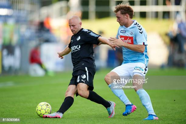 Johnny Thomsen of Randers FC and Christian Jakobsen of SonderjyskE compete for the ball during the Danish Alka Superliga match between SonderjyskE...