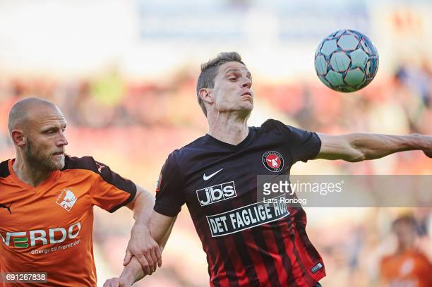 Johnny Thomsen of Randers FC and Jonas Borring of FC Midtjylland compete for the ball during the Danish Alka Superliga Europa League Playoff match...