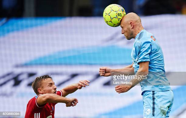 Johnny Thomsen of Randers FC and Pierre Bengtsson of FC Copenhagen compete for the ball during the Danish Alka Superliga match between Randers FC and...
