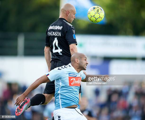 Johnny Thomsen of Randers FC and Simon Poulsen of SonderjyskE heading the ball during the Danish Alka Superliga match between SonderjyskE and Randers...