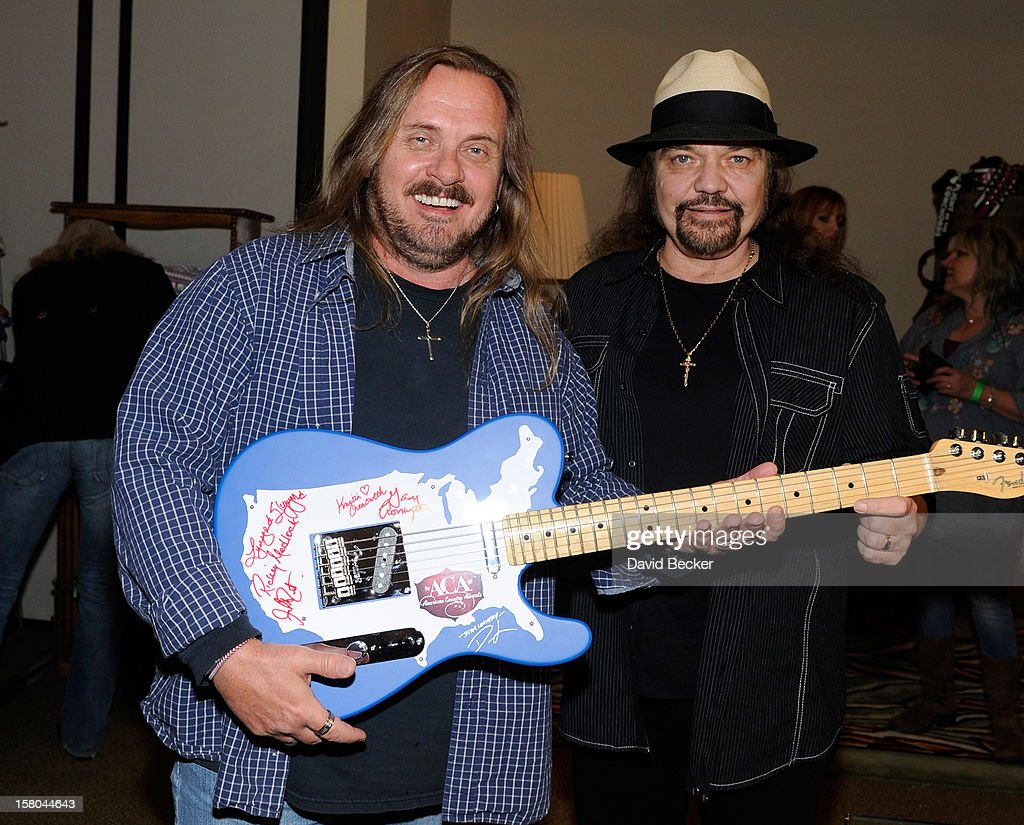 <a gi-track='captionPersonalityLinkClicked' href=/galleries/search?phrase=Johnny+Van+Zant&family=editorial&specificpeople=213799 ng-click='$event.stopPropagation()'>Johnny Van Zant</a> (L) and <a gi-track='captionPersonalityLinkClicked' href=/galleries/search?phrase=Gary+Rossington&family=editorial&specificpeople=577186 ng-click='$event.stopPropagation()'>Gary Rossington</a> of Lynyrd Skynyrd attend the Backstage Creations Celebrity Retreat at 2012 American Country Awards at the Mandalay Bay Events Center on December 9, 2012 in Las Vegas, Nevada.