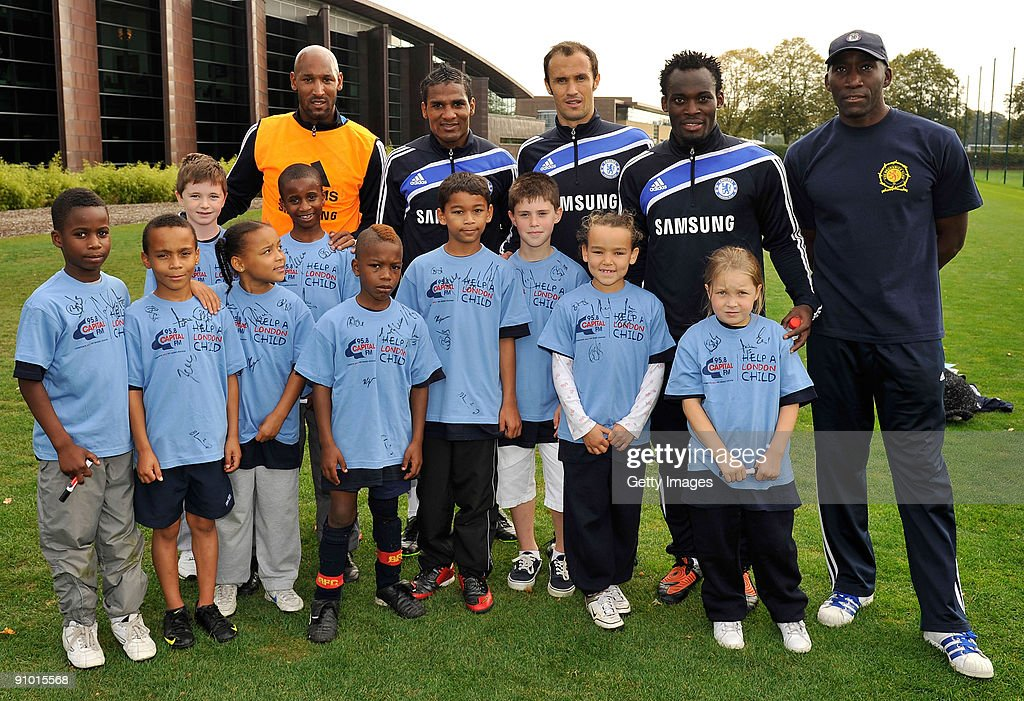 Johnny Vaughan and Lisa Snowdon of Capital Radio pose with Florent Malouda Ricardo Carvalho and Michael Essien of Chelsea during the launch of...