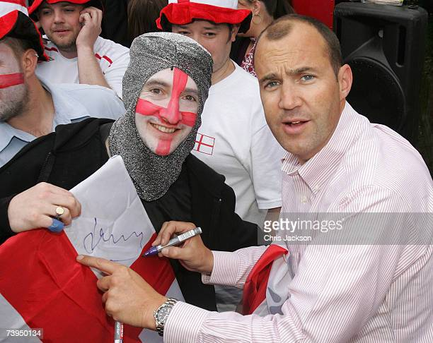 Johnny Vaughan signs Elliot Dix's flag during the Capital Radio St Georges Day Recording at Ye Old St Georges Pub in Beckenham on April 23 2007 in...