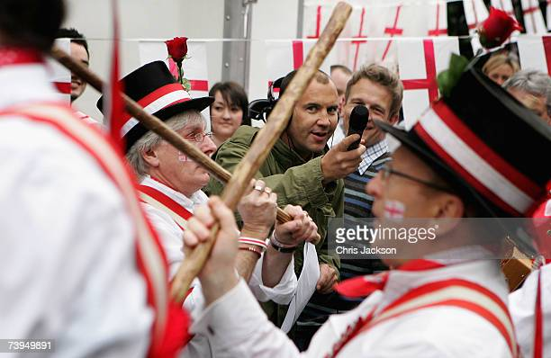 Johnny Vaughan watches morris dancers during the Capital Radio St Georges Day Recording at Ye Old St Georges Pub in Beckenham on April 23 2007 in...
