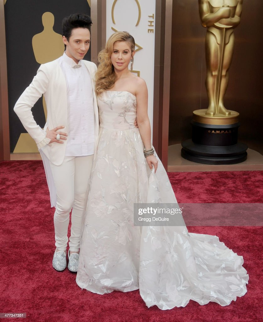 <a gi-track='captionPersonalityLinkClicked' href=/galleries/search?phrase=Johnny+Weir&family=editorial&specificpeople=208701 ng-click='$event.stopPropagation()'>Johnny Weir</a> and <a gi-track='captionPersonalityLinkClicked' href=/galleries/search?phrase=Tara+Lipinski&family=editorial&specificpeople=213748 ng-click='$event.stopPropagation()'>Tara Lipinski</a> arrive at the 86th Annual Academy Awards at Hollywood & Highland Center on March 2, 2014 in Hollywood, California.