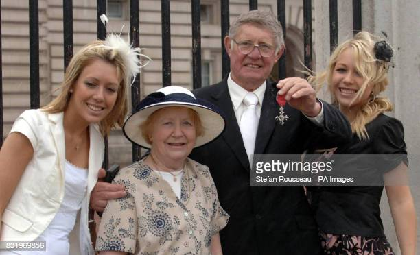 Johnny Whiteley wife Joan and his daughters Lisa and Sheridan at Buckingham Palace after he received an MBE from Britain's Queen Elizabeth II