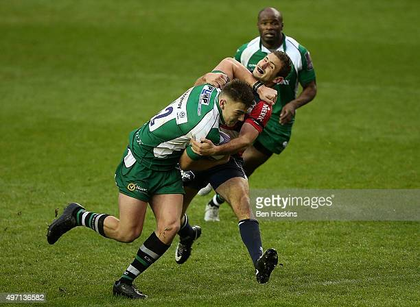 Johnny Williams of London Irish fends off the tackle of Francois Bouvier of Agen during the European Rugby Challenge Cup match between London Irish...