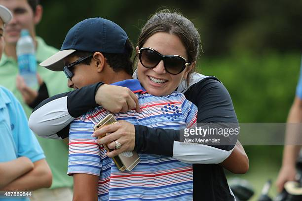 Johnny Wright gets a hug from his mother Erika after scoring a 60 in the putting category during a regional round of the 2015 Drive Chip and Putt...
