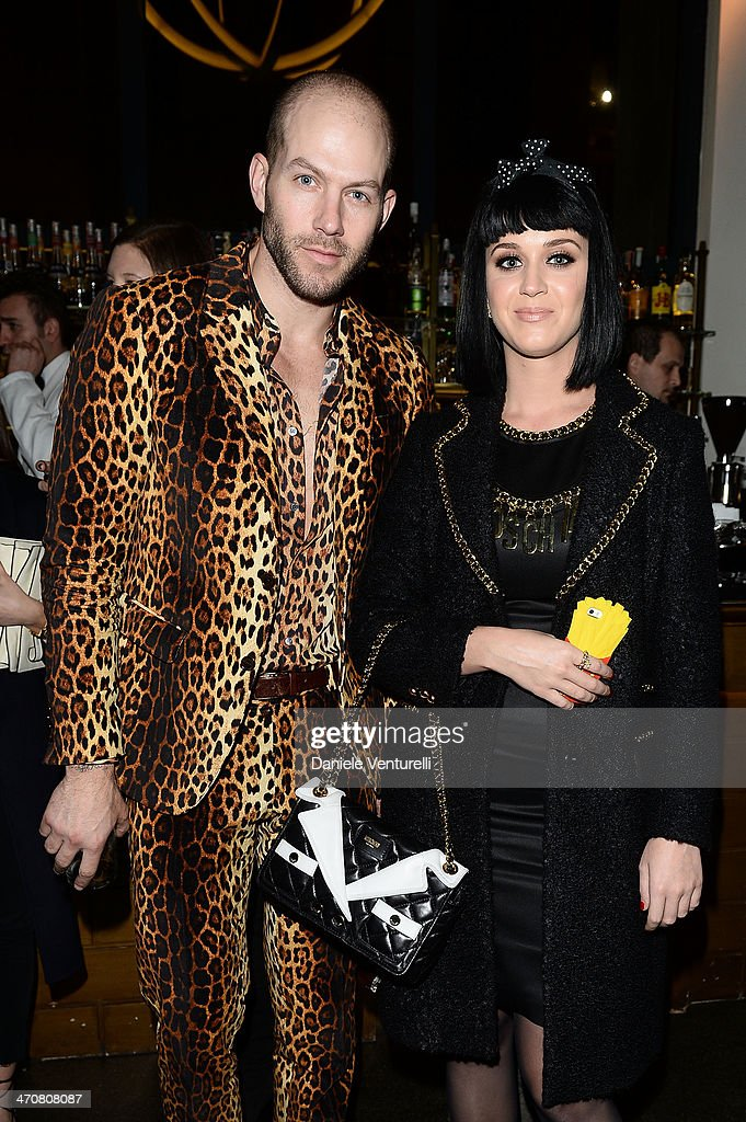 Johnny Wujek and <a gi-track='captionPersonalityLinkClicked' href=/galleries/search?phrase=Katy+Perry&family=editorial&specificpeople=599558 ng-click='$event.stopPropagation()'>Katy Perry</a> attend Moschino Dinner during the Milan Fashion Week Womenswear Autumn/Winter 2014 at Giacomo Arengario Restaurant on February 20, 2014 in Milan, Italy.