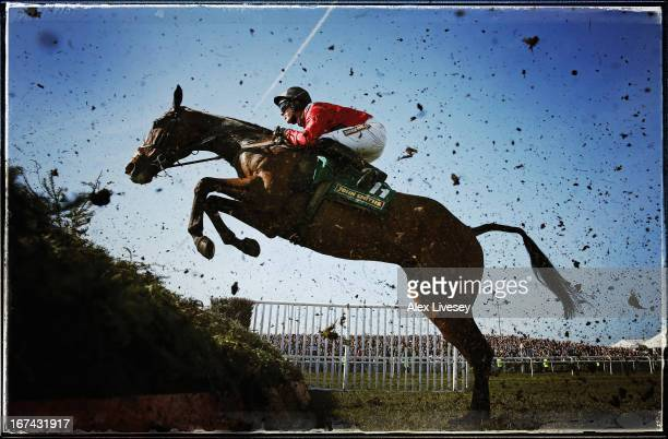 Johns Spirit ridden by Richie McLernon jumps a fence during The John Smith's Handicap Steeple Chase at Aintree Racecourse on April 6 2013 in...