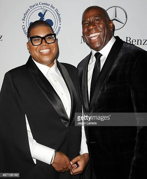 Johnson and Earvin 'Magic' Johnson attend the 2014 Carousel of Hope Ball at The Beverly Hilton Hotel on October 11 2014 in Beverly Hills California