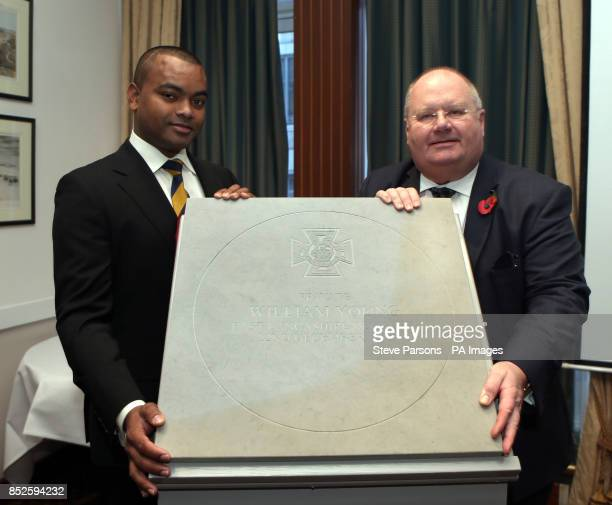 Johnson Beharry and Eric Pickles unveil a paving stone at the Army and Navy Club in Central London which will commemorate recipients of the Victoria...