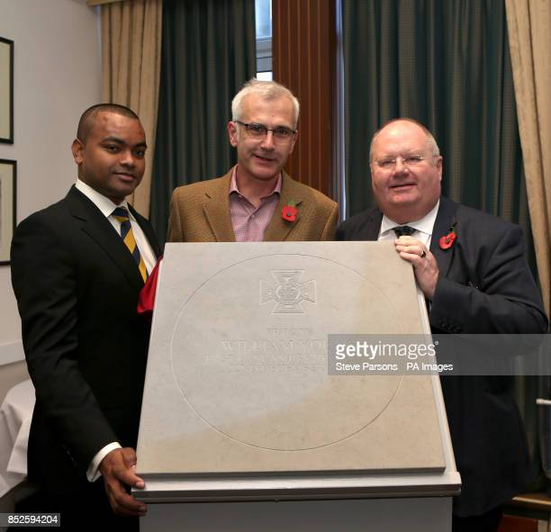 Johnson Beharry with winner Charlie MacKeith and Eric Pickles unveil a paving stone at the Army and Navy Club in Central London which will...