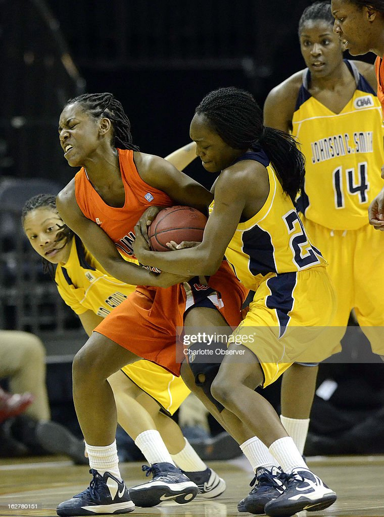 Johnson C. Smith University's Kaylah Gholson (10), battles for control of the ball with Lincoln University's Tahlar McIntosh (40) during the CIAA women's basketball tournament at Time Warner Cable Arena in Charlotte, North Carolina, Tuesday, February 26, 2013. Lincoln defeated Smith, 50-46.