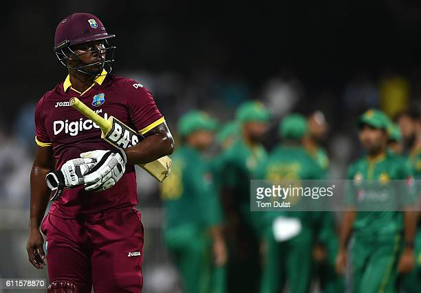 Johnson Charles of West Indies leaves the field after being dismissed by Muhammad Amir of Pakistan during the first One Day International match...