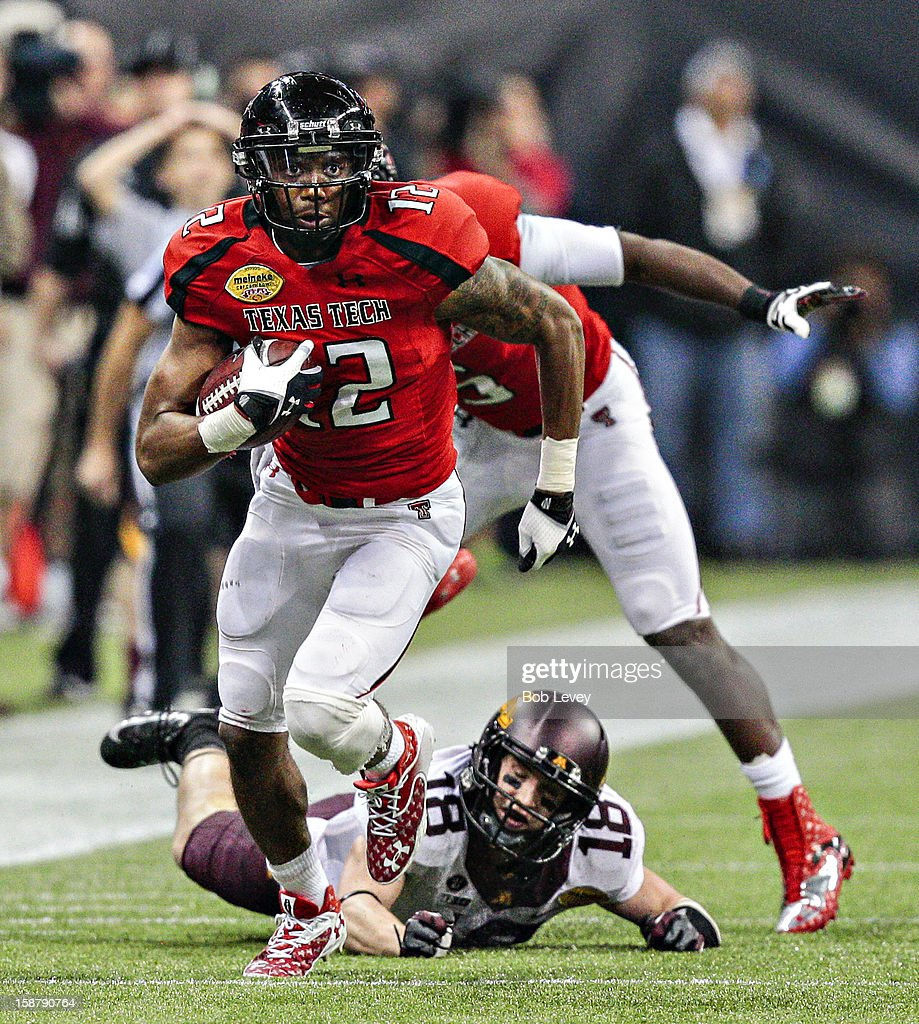 D.J. Johnson #12 of the Texas Tech Red Raiders intercepts a pass intended for Derrick Engel #18 of the Minnesota Golden Gophers during the Meineke Car Care of Texas Bowl at Reliant Stadium on December 28, 2012 in Houston, Texas. Texas Tech defeated Minnesota 34-31.