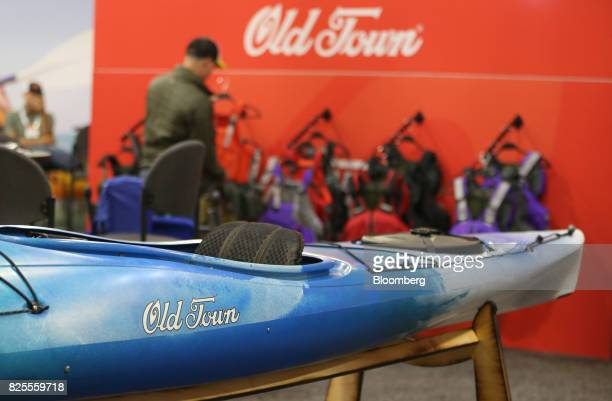 A Johnson Outdoors Watercraft Inc Old Town brand kayak sits on display during the Outdoor Retailer Summer Market Show in Salt Lake City Utah US on...