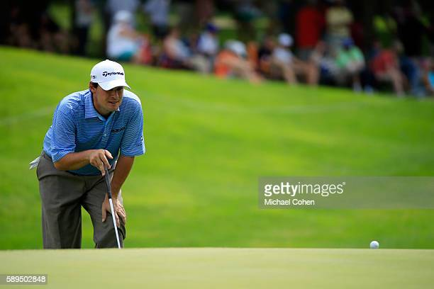 Johnson Wagner lines up a putt on the eighth green during the final round of the John Deere Classic at TPC Deere Run on August 14 2016 in Silvis...