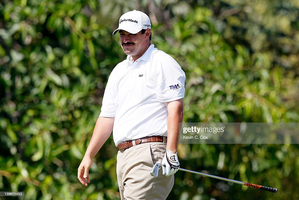 <a gi-track='captionPersonalityLinkClicked' href=/galleries/search?phrase=Johnson+Wagner&family=editorial&specificpeople=2130525 ng-click='$event.stopPropagation()'>Johnson Wagner</a> of the United States watches his tee shot on 10th hole during the first round of the Mayakoba Golf Classic at Riviera Maya-Cancún held at El Camaleon Golf Club at Mayakoba on February 23, 2012 in Playa del Carmen, Mexico.